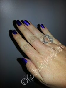 Opi_Tomorrow_never_dies_Hand_Ring